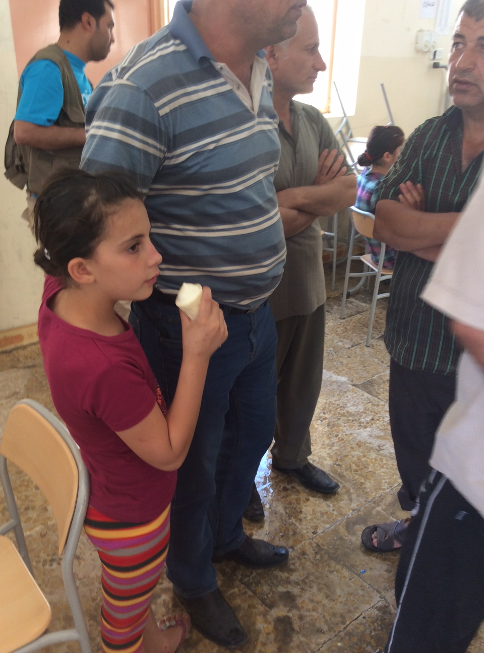 Riva, displaced girl in Iraq in school turned public shelter for the internally displaced.