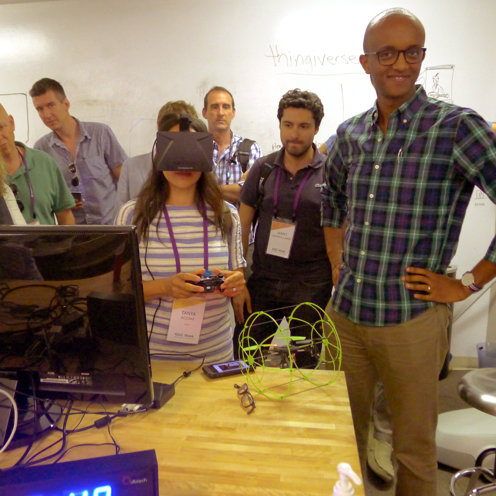 The UNICEF group gets a demo of the Oculus Rift, a virtual reality headset, at the Singularity University Lab. © UNICEF 2014/Holmes
