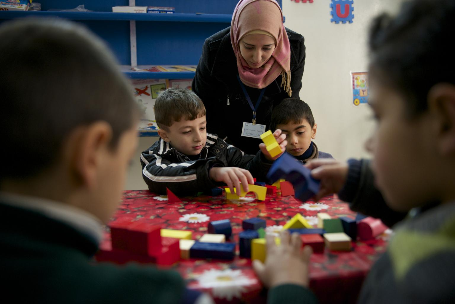 Boys play with block at a UNICEF-supported kindergarten in Homs. © UNICEF/NYHQ2013-1332/Noorani