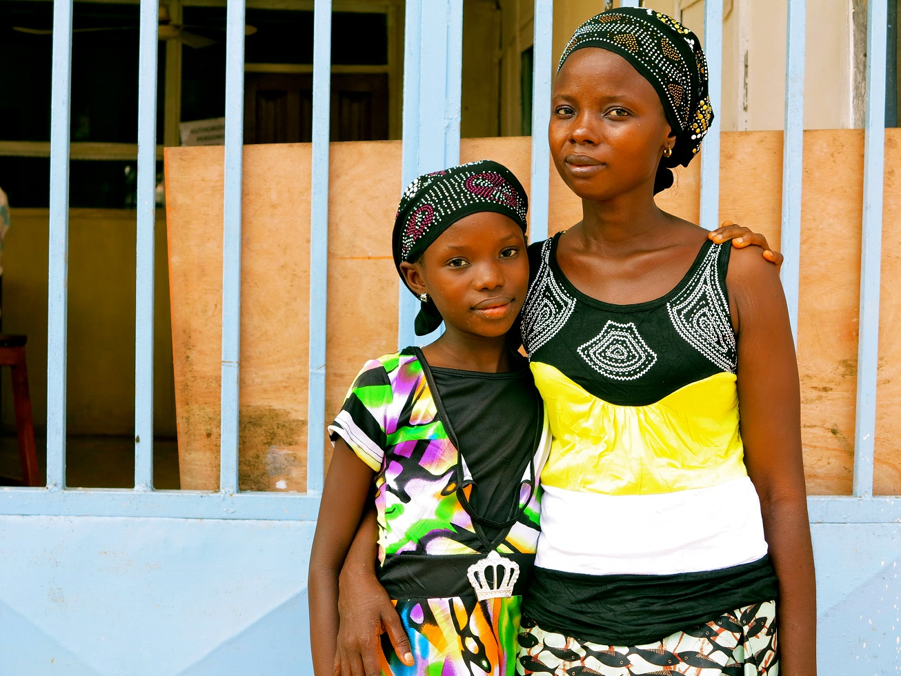 Fatmata stands and her 11-year-old daughter, Tata, are both survivors of Ebola from Sierra Leone. © UNICEF/NYHQ2014-1059/Dunlop