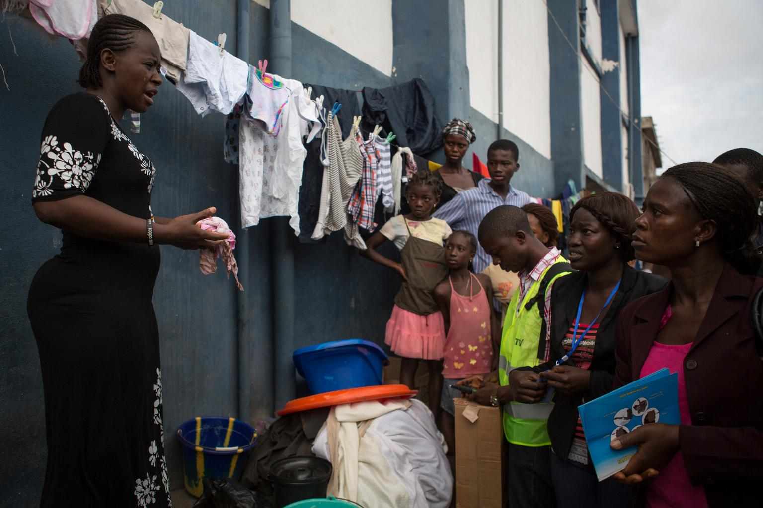 On 19 September, a social mobilizer speaks with residents about protecting themselves against Ebola.