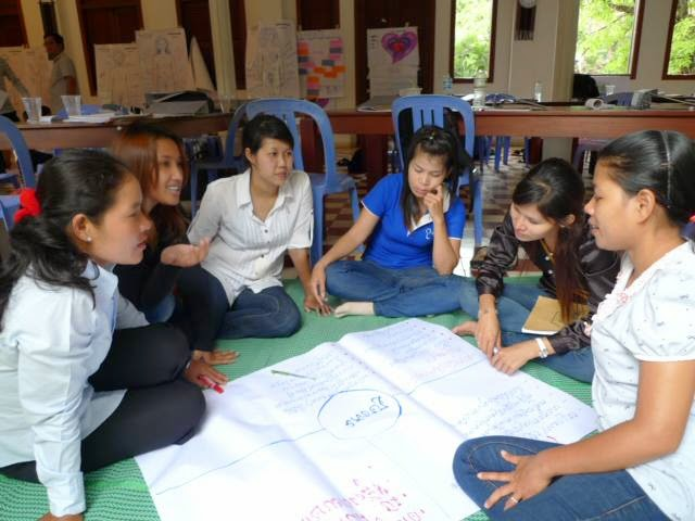 Socheat (second left) works with a small group of NGO trainees in Siem Reap, Cambodia, encouraging discussion and sharing of their ideas and experiences during the FSC Social Work Training, which focuses on children who have experienced sexual abuse.