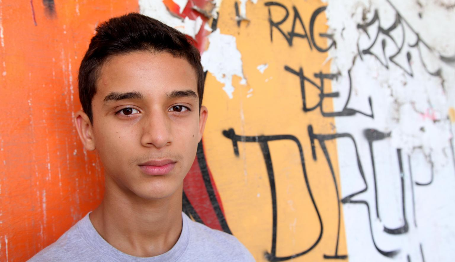 In Italy, Walid (14) stands outside the Alkadia youth centre, in Turin. The centre provides youths, most of whom are from disadvantaged families, with recreational and cultural activities, as well as help with schoolwork.
