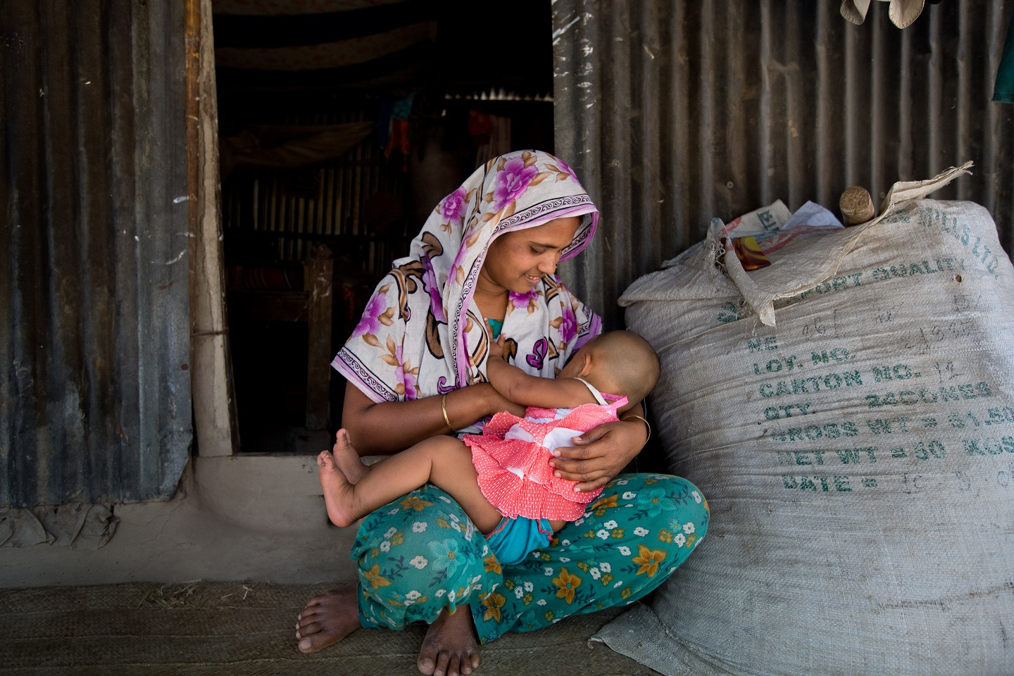 Sadia, 8-months-old is breastfed by her mother, in Bhaluka, Bangladesh.