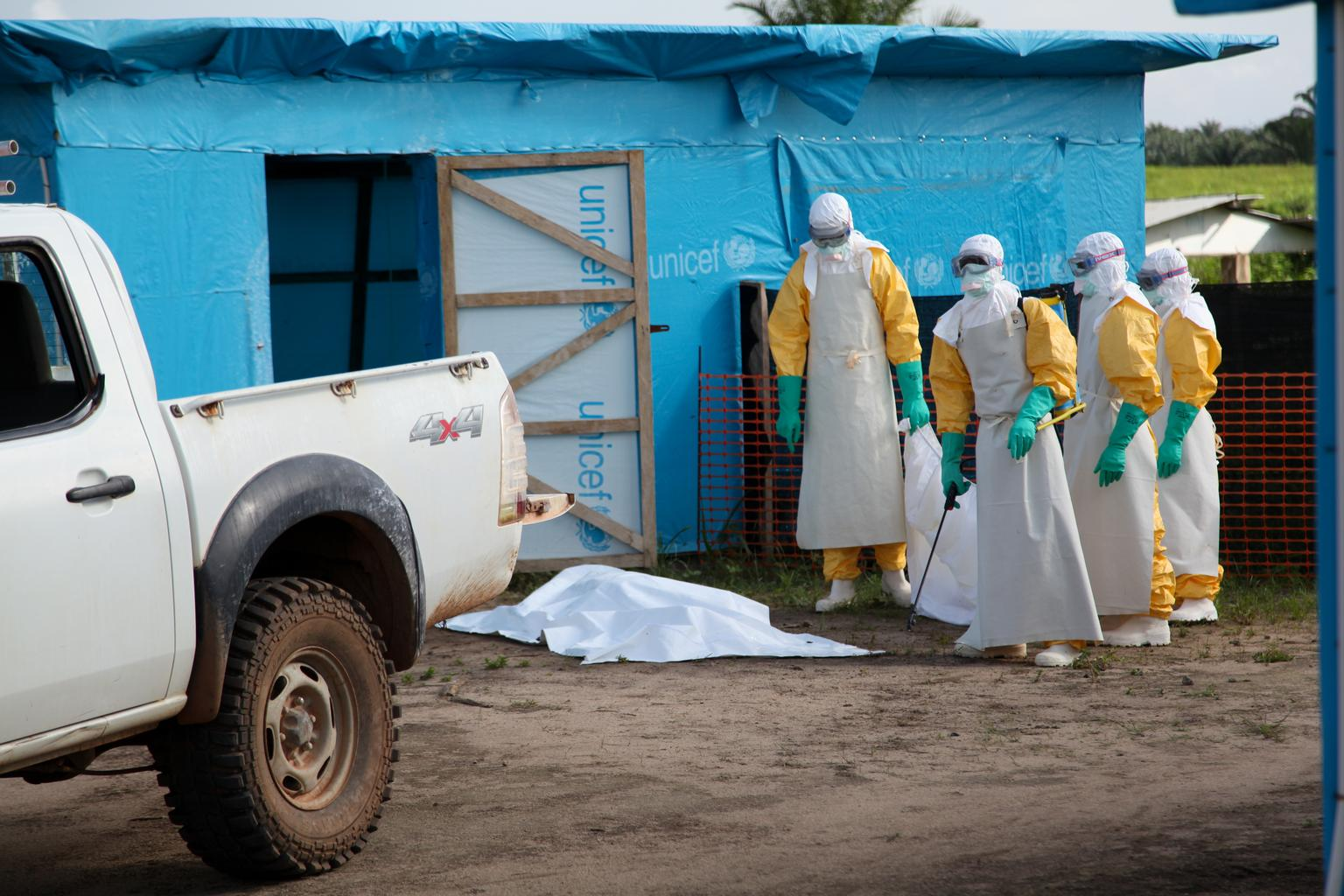 Health workers, wearing head-to-toe protective gear, prepare for work outside an isolation unit in Foya District, Lofa County. © UNICEF/2014/Liberia/Jallanzo