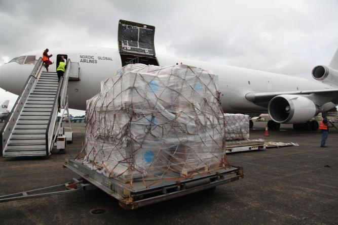 Emergency supplies airlifted by UNICEF to support the national Ebola response are unloaded from a chartered cargo plane at Monrovia's Roberts International Airport. ©UNICEF/NYHQ2014-1300