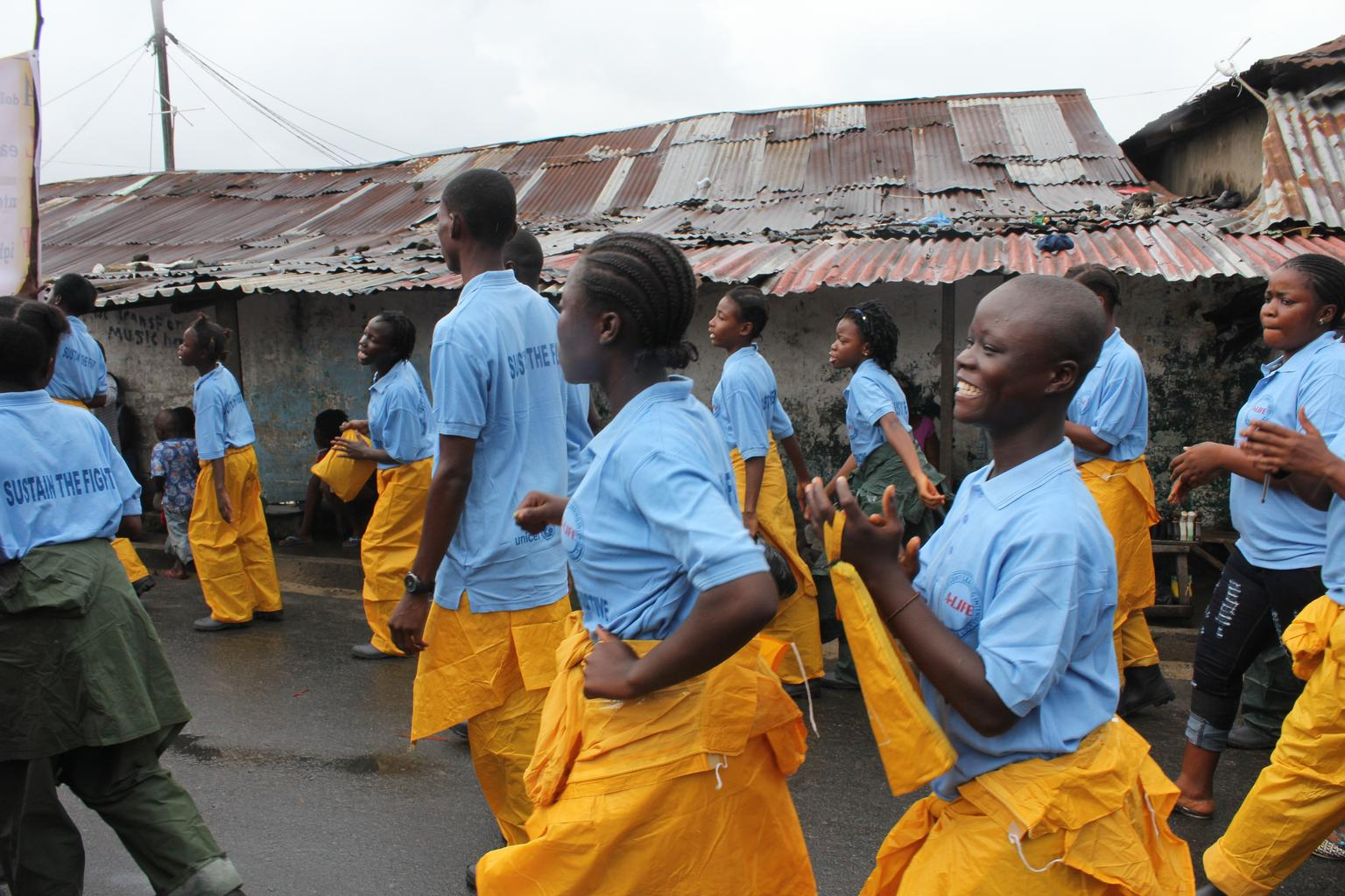 """In Liberia, adolescent girls trained by UNICEF and partners are part of Adolescents Leading the Intensive Fight against Ebola, or """"A-LIFE"""". Equipped with awareness materials, these girls go door-to-door to educate their parents, family members and friends about Ebola and how it can be prevented."""
