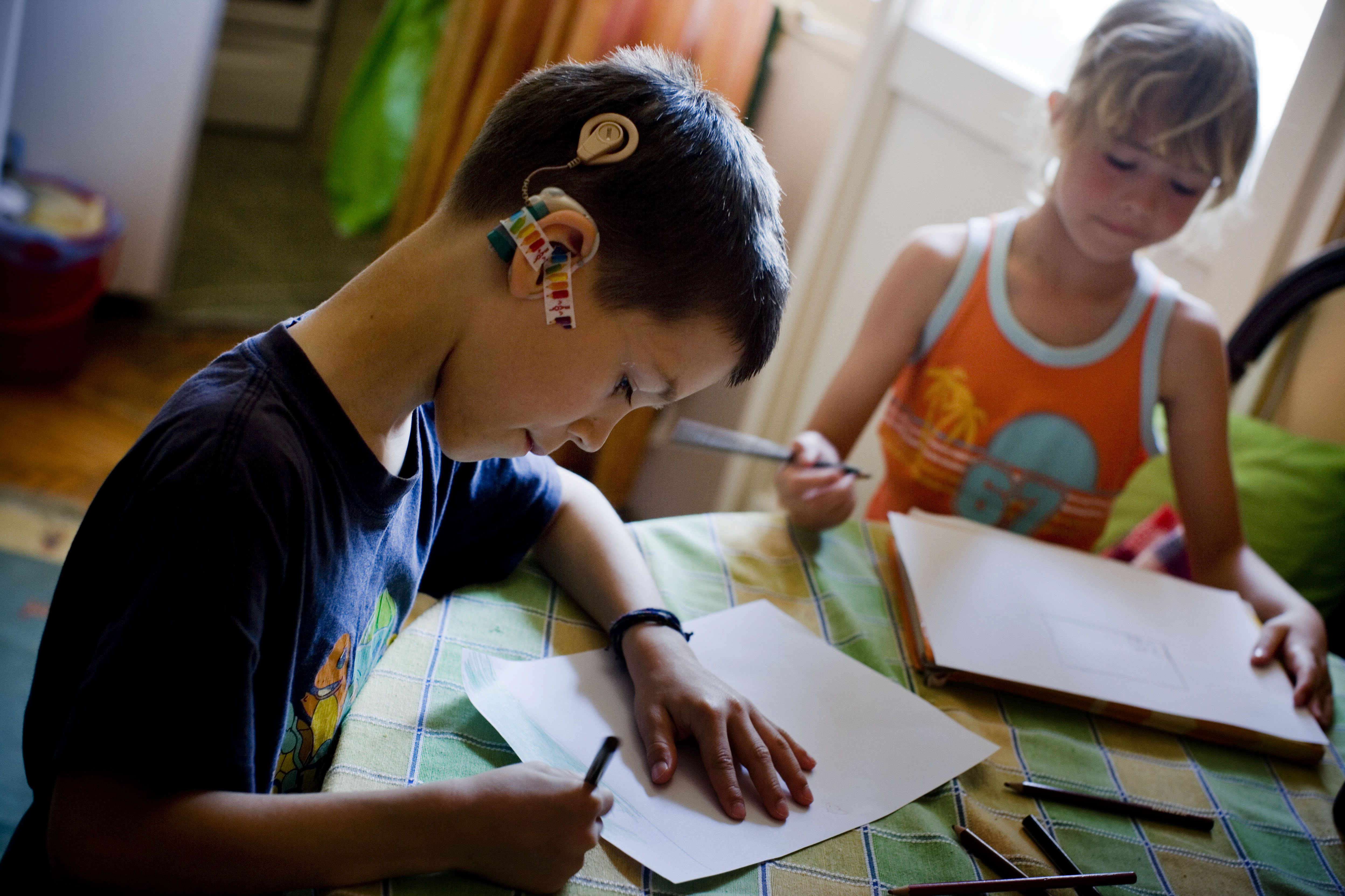 Children in Serbia use assistive technology to do their homework.