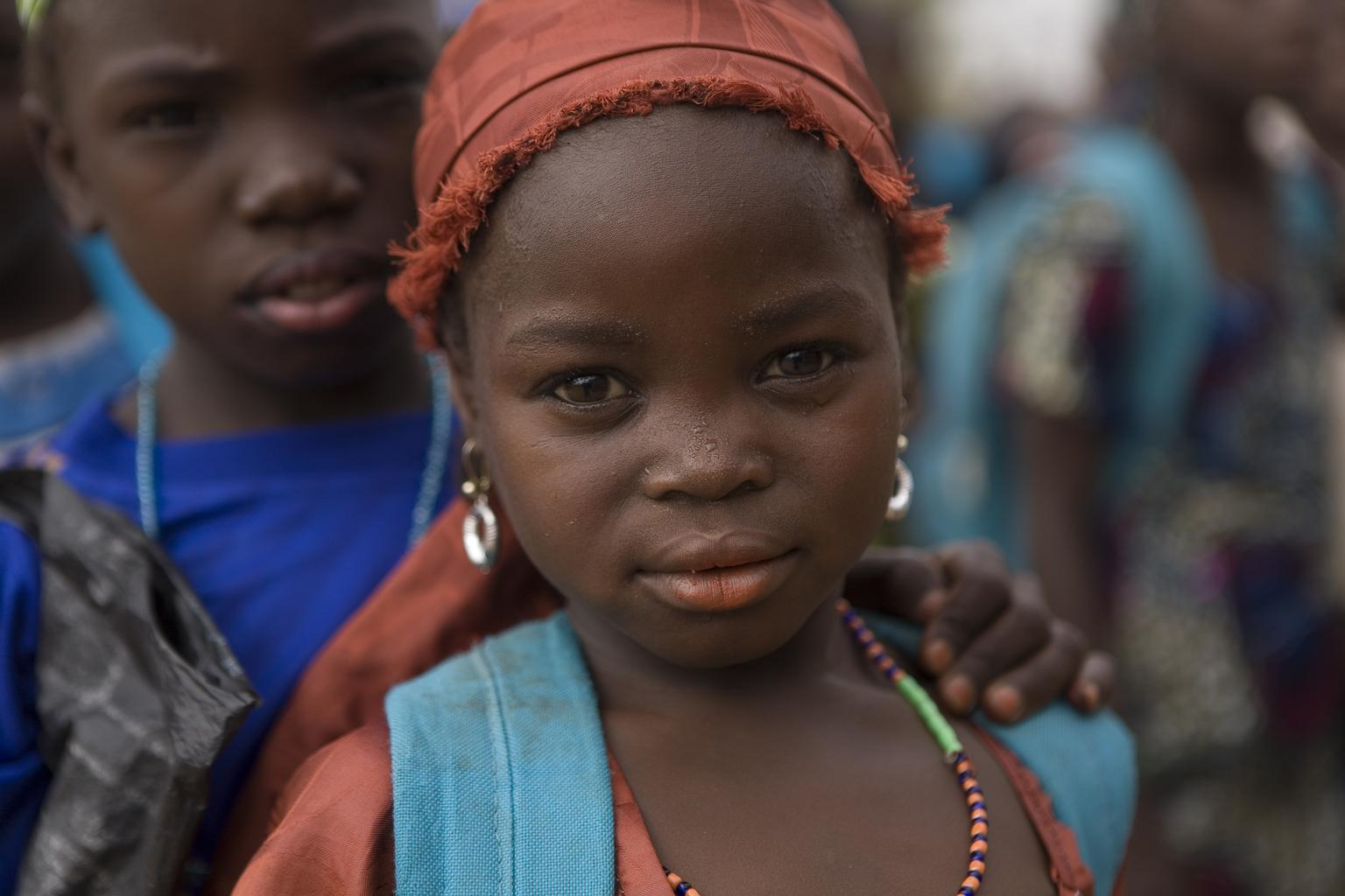 Goumbo (7) stands among other children outside her school in the village of Dan Gora, Niger.