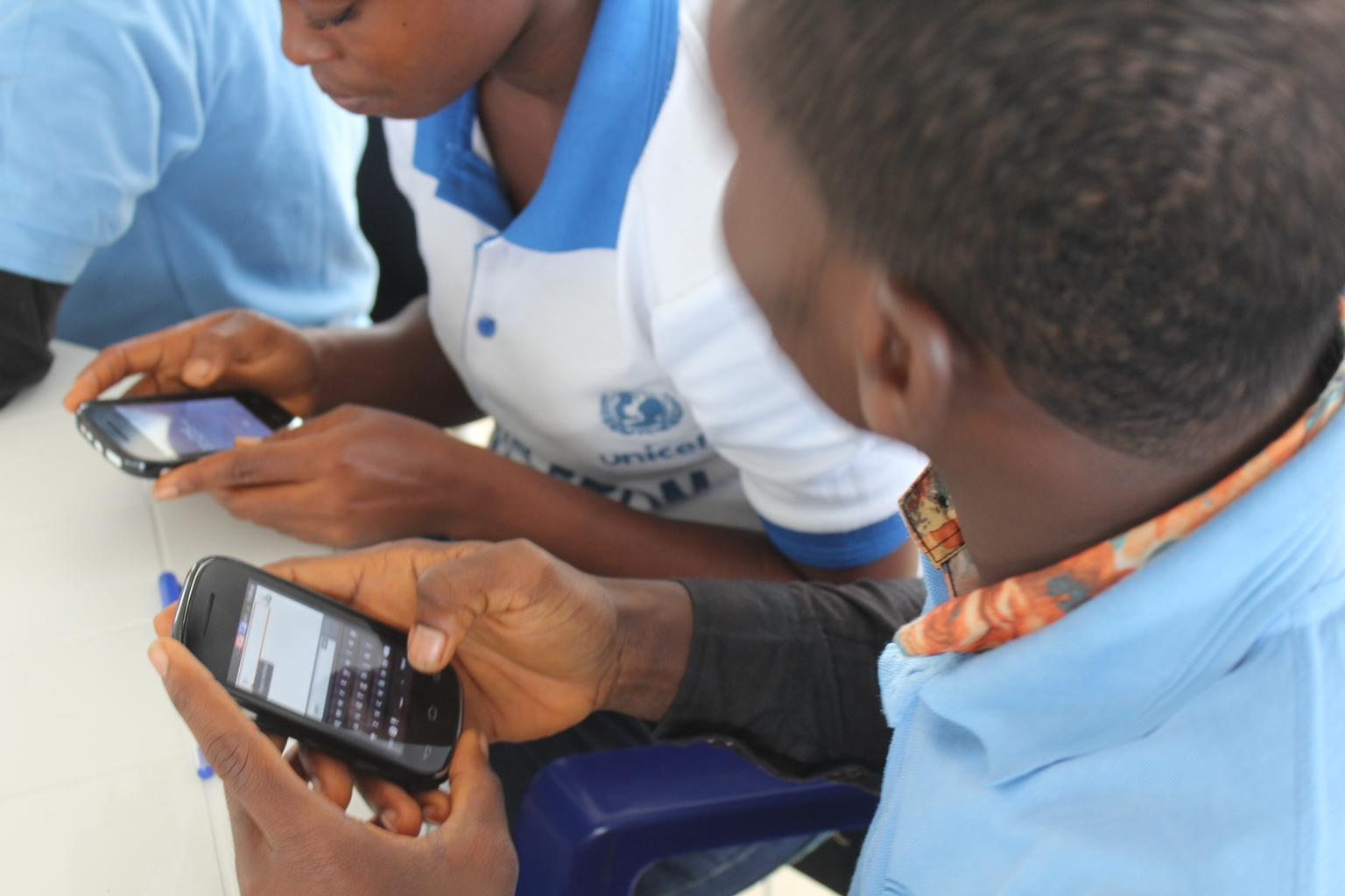 n Liberia, UNICEF-supported social mobilizers from the group A-LIFE, learn to record survey data using their mobile phones.