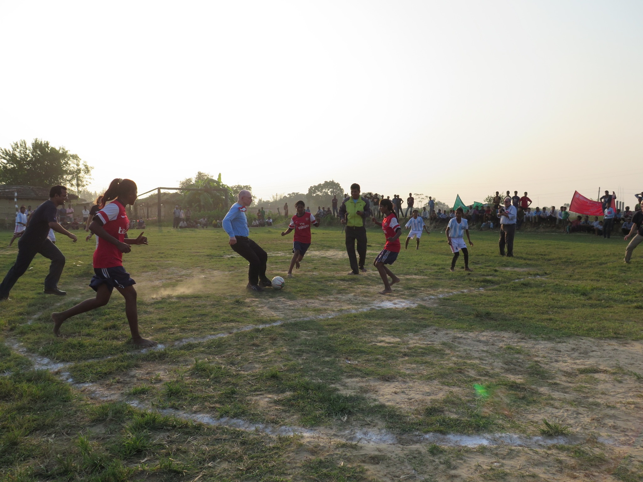 Kick-off in Nepal: the girls of the after-school sports programme take on the UNICEF visitors.