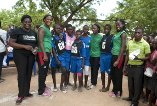 The Queens (Malawi National Netball Team) with the netball team of the Bangula FP School.