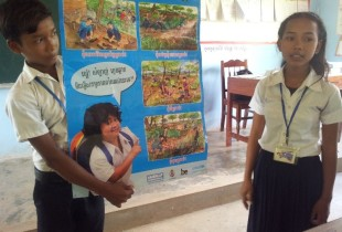 Sreymom and her peer provides a mine risk education lesson to students at Grand 4 in Chisang Primary School, Cambodia.