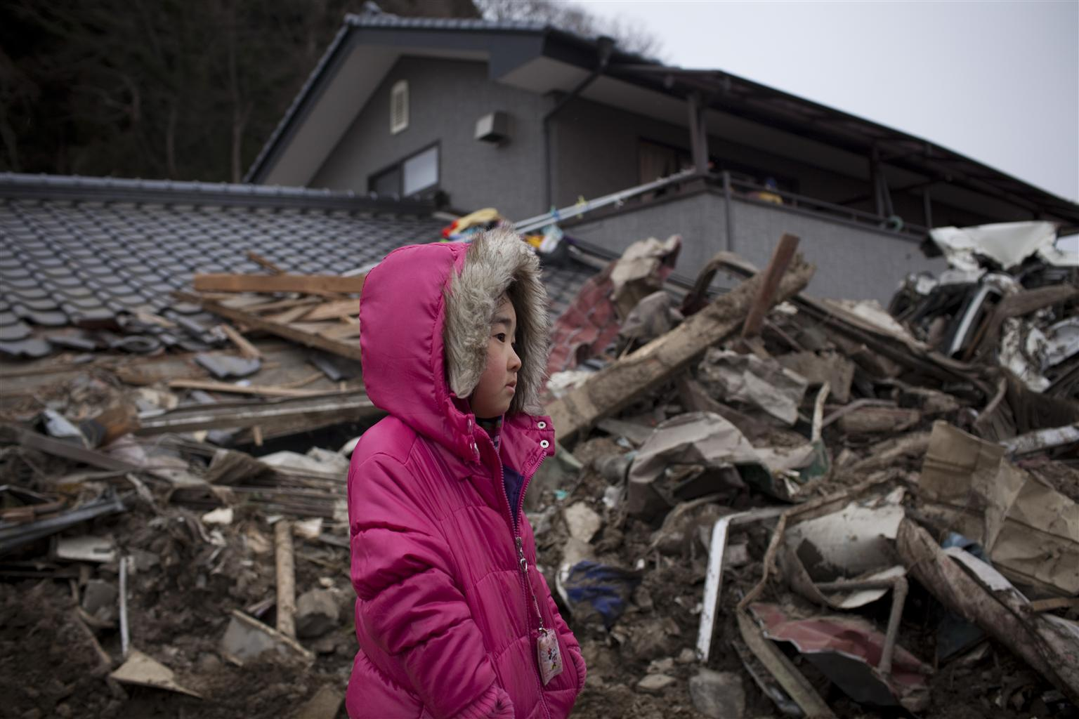 Neena (5) surveys the wreckage of her home, which was destroyed by the 2011 tsunami in Japan.