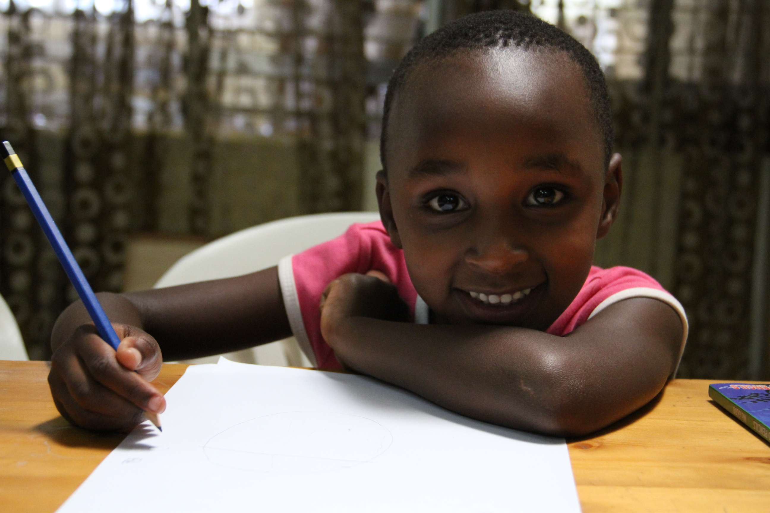 Children participate in a national drawing contest on A Better World for Children during CRC@25 celebrations in Burundi