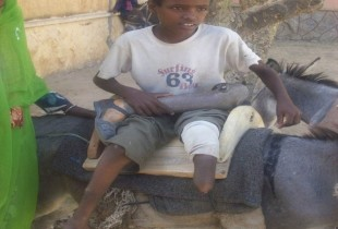 With the help of a donkey and artificial limbs, Hasen is able to attend school.