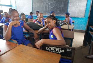 School girls in Sierra Leone's capital Freetown on the first day of school after an eight-month break due to Ebola.