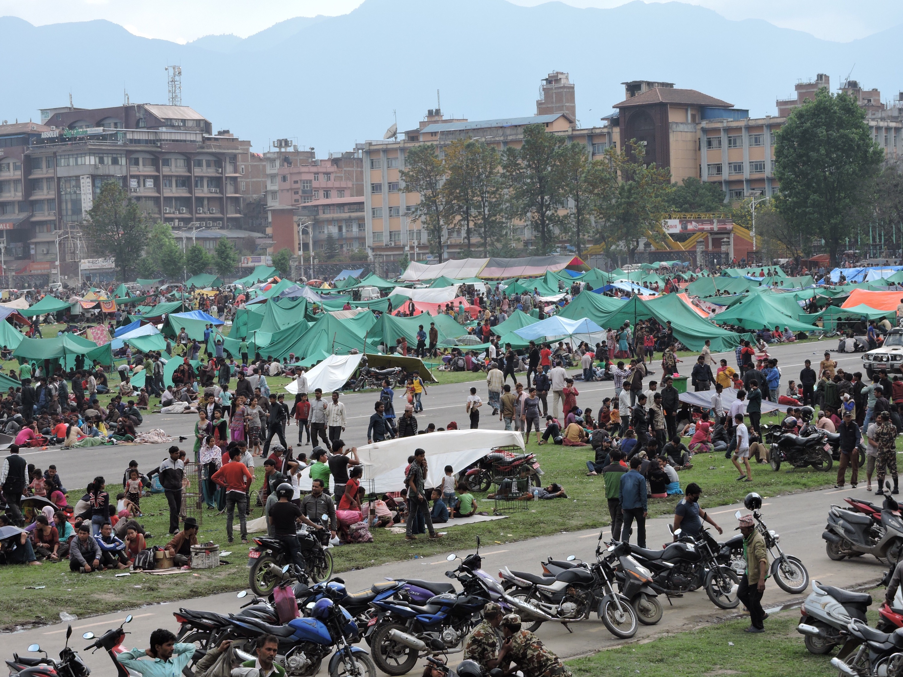 Displaced families gather in an open field following the earthquake in Nepal.