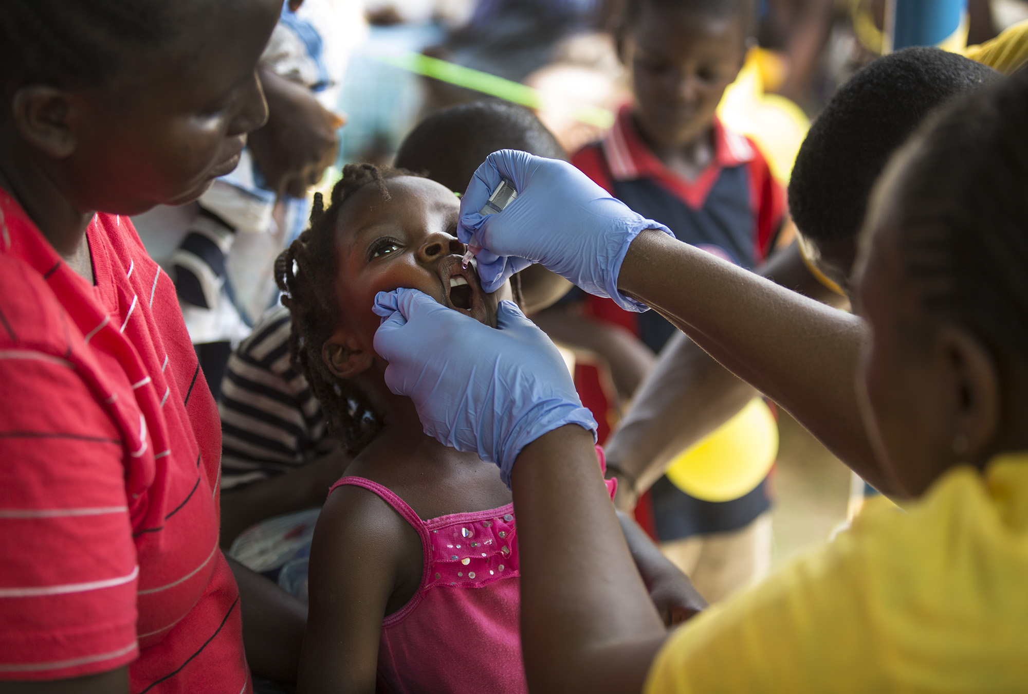 Three-year-old Stephanie receives the polio vaccine.