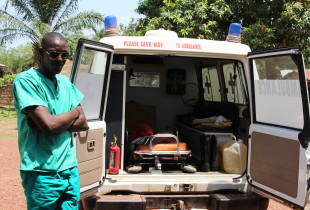 A member of the 'open day' team stands by the ambulance in Kabaya.