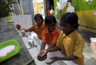 School children in India wash their hands prior to the mid-day meals.