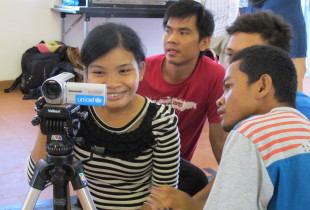 21-year-old Saron, who is visually impaired, learns to use a video camera for the first time at the One Minutes Jr. workshop in Kampot, Cambodia.