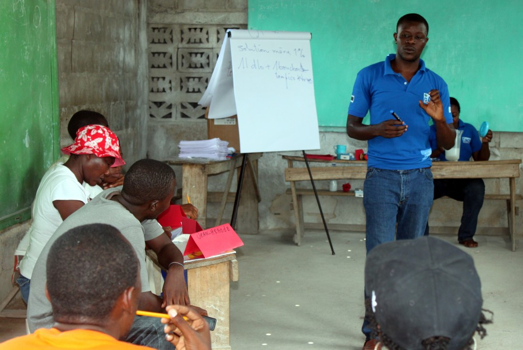 An ACF agent conducts a refresher training for community volunteers.