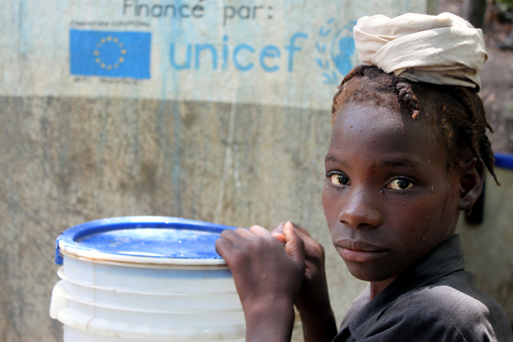A child fetches water from a local waterpoint.