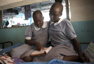 Sisters complete schoolwork together in Kenya