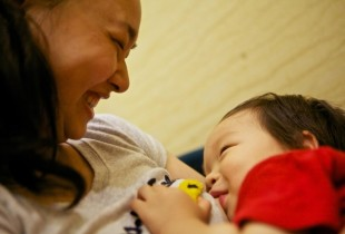 A mother and child from China bond during breastfeeding.