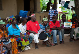 Korobrobai Kabbia, Chairman of the Traditional Healers (in red, in centre) gathers traditional healers and members of the communty to discuss Ebola prevention and the role of traditional healers.
