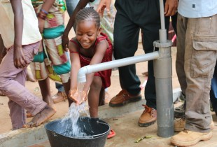 In Ouango, a district of Bangui, a little girl enjoys clean, running water thanks to the new system.
