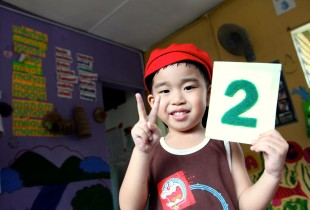 A boy from the indigenous Kadazandusun ethnic group in Malaysia attends a preschoool class.