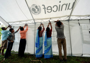 Simjung health post staff set up UNICEF medical tent to establish a birthing centre there.