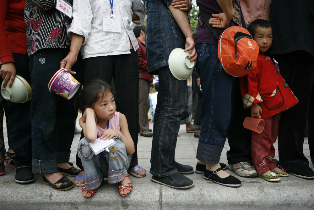 A young girl waiting in line for food