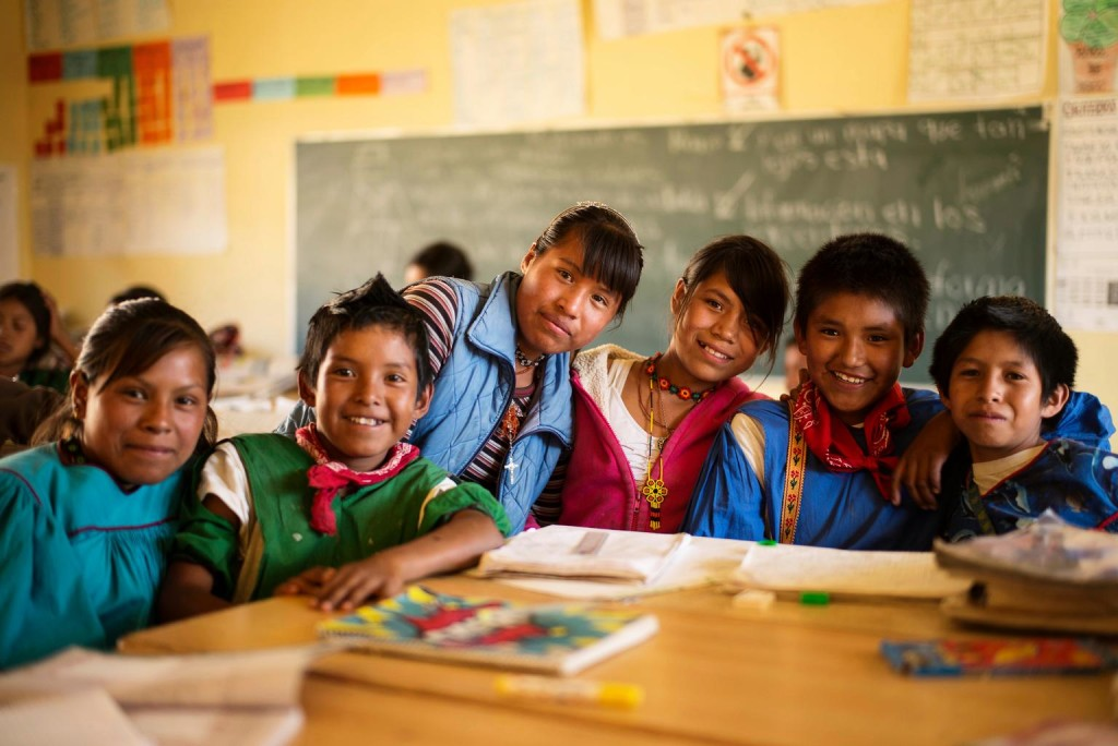 Kids around a table in a classroom