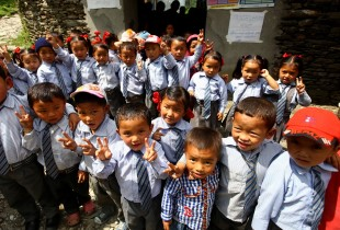 Children in school uniforms after a group vaccination.
