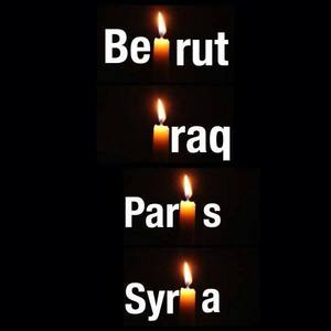 A series of candles labelled Paris, Beirut, Iraq, Syria