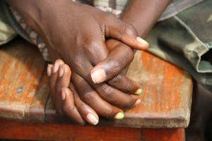 Close-up of a young boy's hands in Burundi