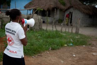 Kadiatu Sankoh from the Sierra Leone Red Cross Society spreading Ebola prevention messages in Magburuka Town.