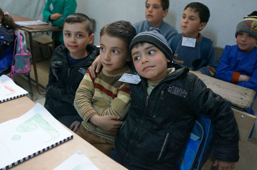 A group of boys in a classroom.