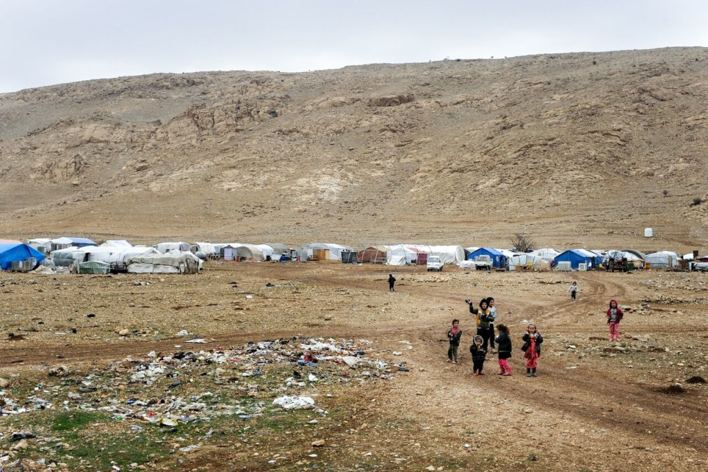 Children in front of a tent camp.