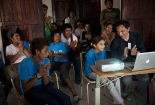 A group of children and a camera projector