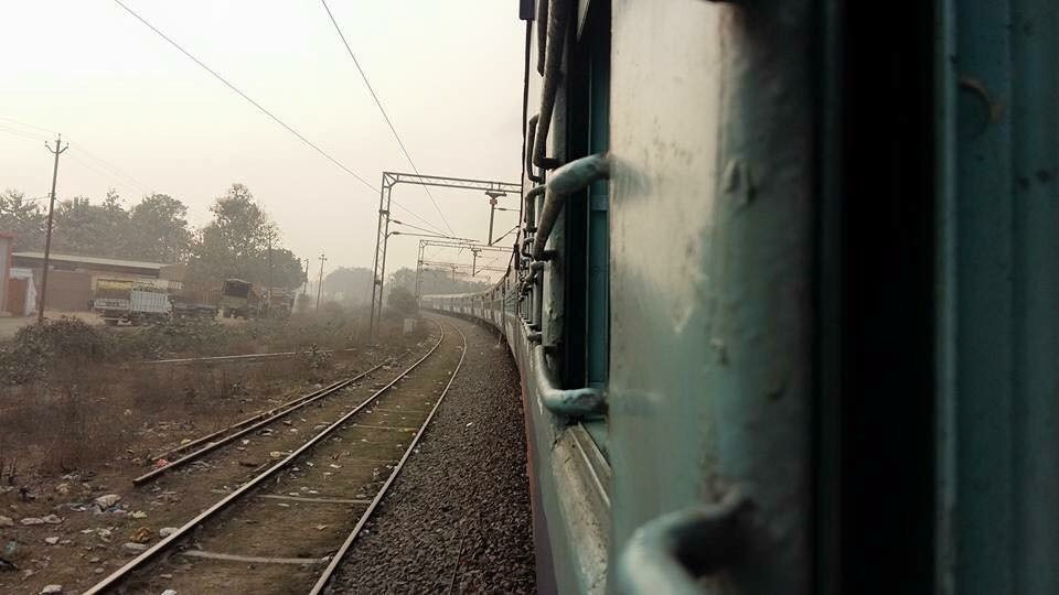 A view of train tracks from within the train.