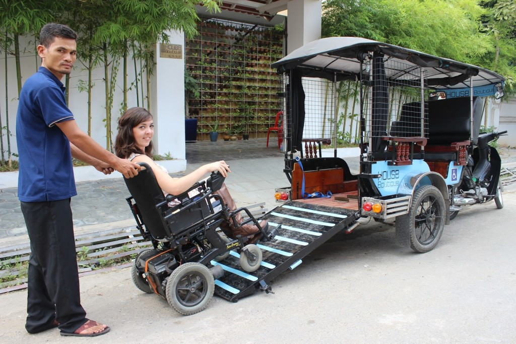 Another photo of the tuk tuk, with the wheelchair being wheeled in.