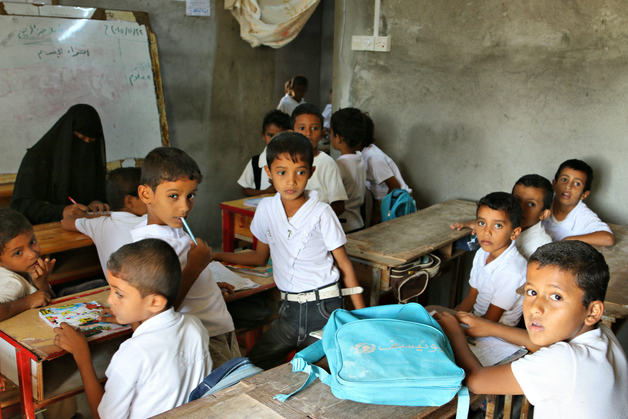 A group of children in a classroom.