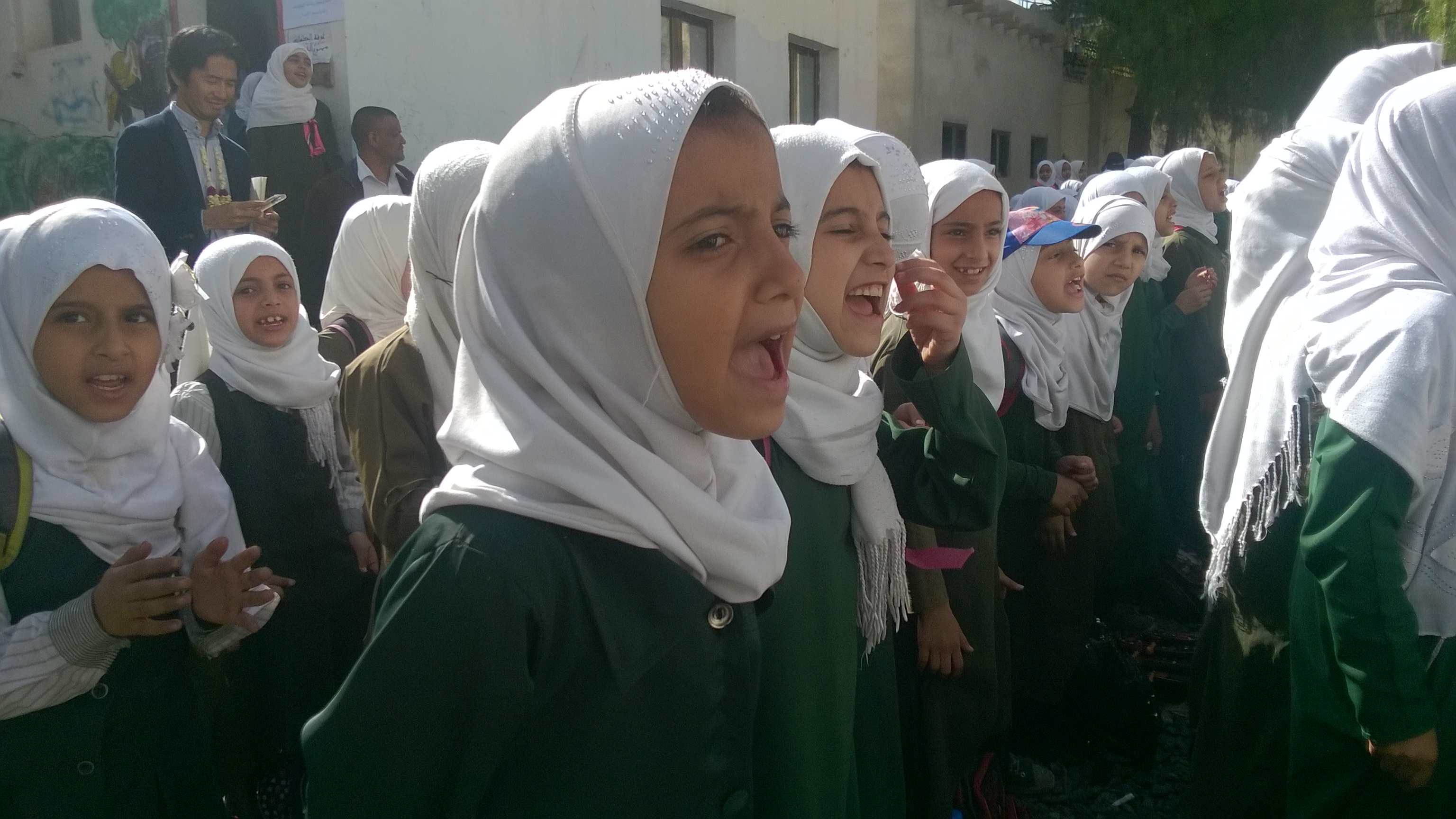 A group of girls singing.
