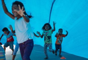 Children playing in a tent.