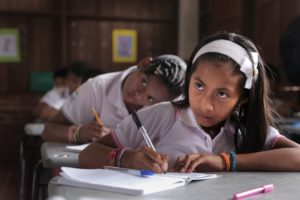 A young girl in class.