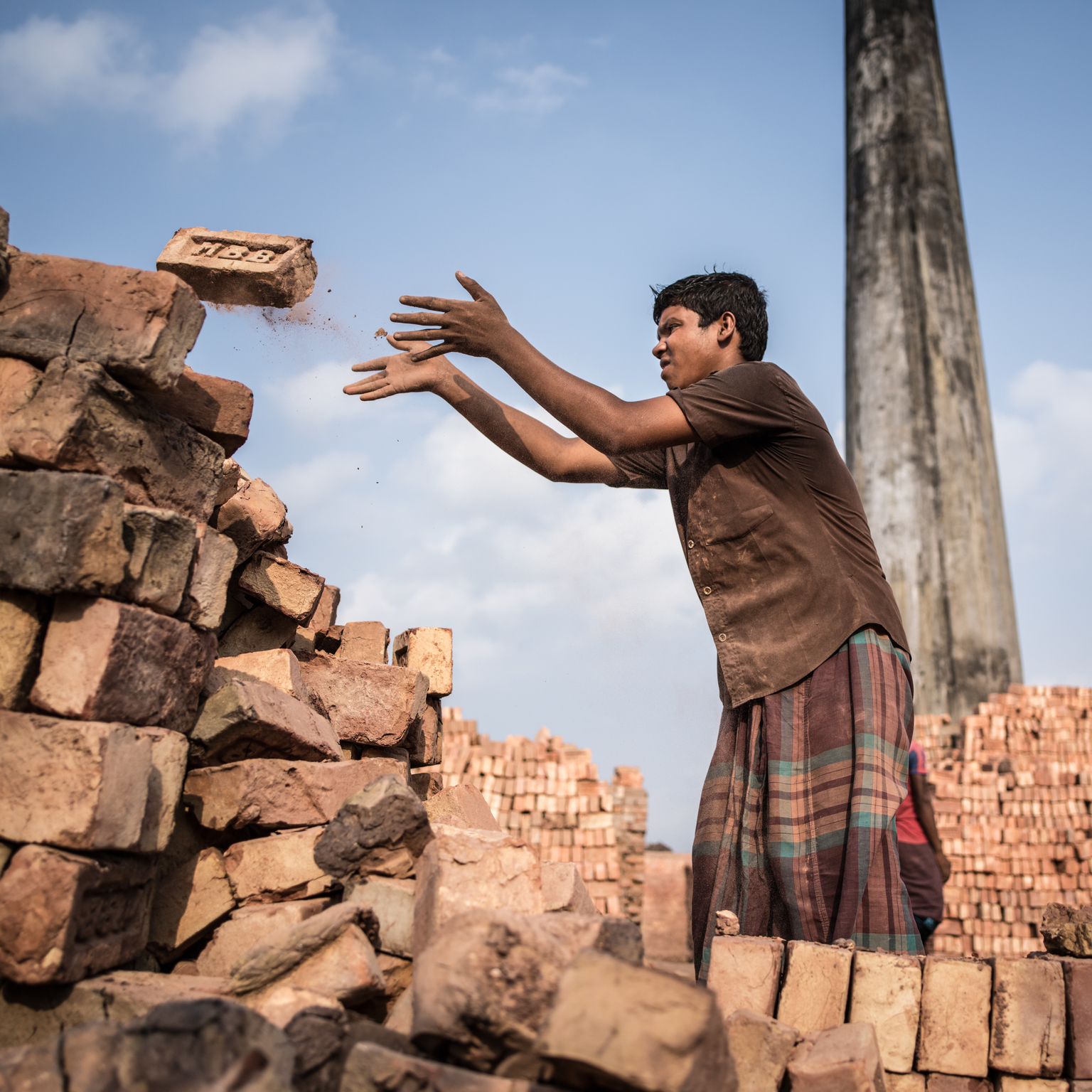 A Boy in a brick factory